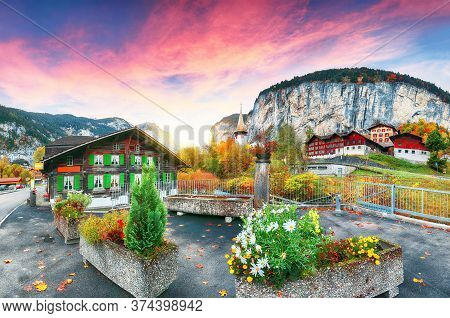 Dramatic Autumn View Of Lauterbrunnen Village  And Swiss Alps In The Background.  Location: Lauterbr