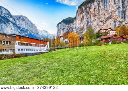 Fantastic Autumn View Of Lauterbrunnen Village With Awesome Waterfall  Staubbach  And Swiss Alps In