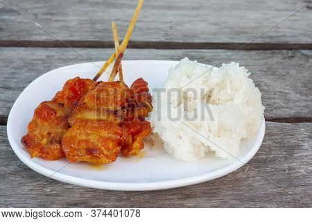 Grilled Pork With Sticky Rice In White Plate Is A Food That Thai People Prefer To Eat, There Are Gen