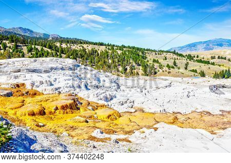 Aerial View Of The Lower Terraces Of Mammoth Hot Springs At Yellowstone National Park With Mount Eve