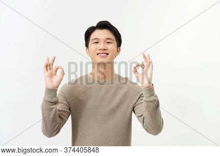 Portrait Of Happy Young Asian Man Dress In Casual Informal Smiling And Posing With Cheerful And Okey