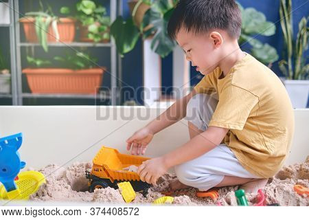Cute Asian Young Boy Playing With Sand Alone At Home, Kid Playing With Sand Toys & Toy Construction