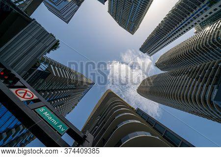 Upward View Of Skyscrapers In The City S Miami Avenue