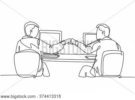 One Continuous Line Drawing Of Two Young Happy Male Worker Bump Their Fist To Celebrate Their Succes