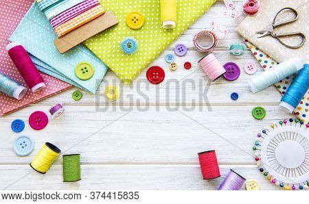 Sewing Accessories And Fabric On A White Background. Sewing Threads, Needles, Pins, Fabric, Buttons