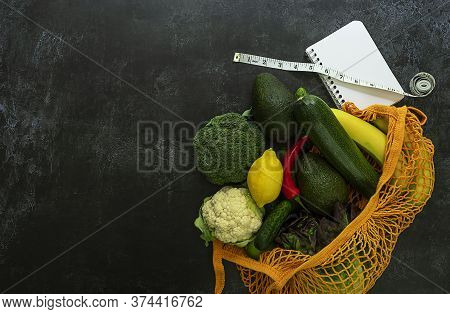 Healthy Grocery Shopping For Loose Weight. String Bag With Vegetables, Fruits, Empty White Notebook,