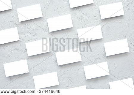 Business Card Mockup Template On Cement Texture Background. Business Cards Arranged In Rows
