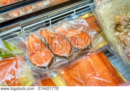 Frozen Red Fish Lies In A Shop Window. Frozen Seafood In Vacuum Packaging.
