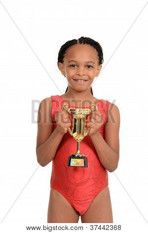 South African child with gymnastics trophy