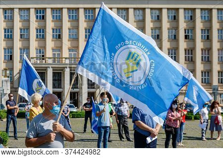 Uzhgorod, Western Ukraine - June 30, 2020: People In Protective Masks Hold Flags Of Trade Unions Of
