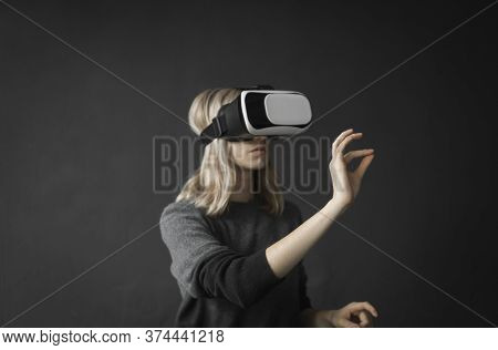Young Woman Wearing Virtual Reality Goggles Headset, Vr Box. Connection, Technology, New Generation,