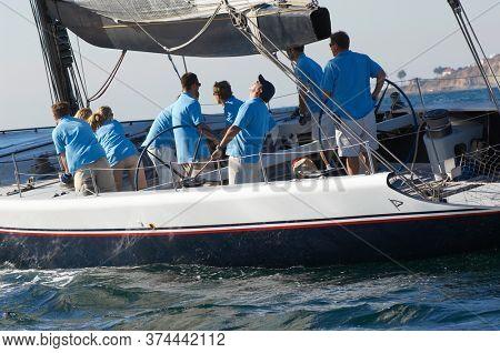 Photo of Sailing team on sailboat