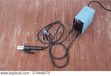 Industrial Tool - Welding Machine On A Wooden Background