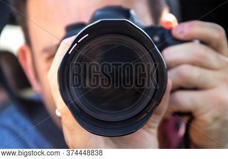 Photographer Through The Lens