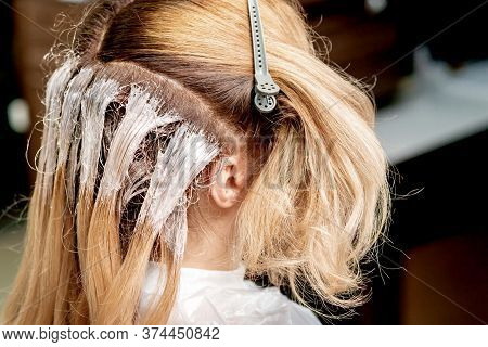 Close Up Dye On Hair Of Woman During Process Of Dyeing Hair In Hair Salon.
