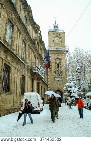 Aix En Provence, France - January 7, 2009: People Walking Under An Unusual Snow In Front Of The Cloc