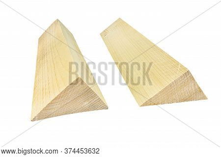 Two Wooden Wedges Isolated On A White Background With A Clipping Path.