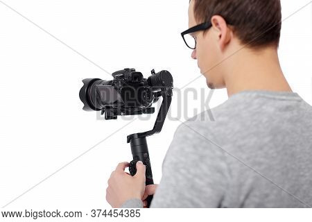 Back View Of Professional Videographer Using Dslr Camera On Gimbal Stabilizer Isolated On White Back