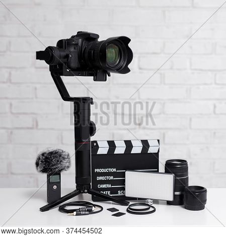 Videography Concept - Modern Dslr Camera On 3-axis Gimbal Stabilizer, Lenses, Microphone, Led Light,