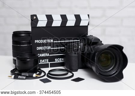 Videography Or Photography Concept - Modern Dslr Camera, Lenses, Filters, Memory Cards And Clapper B