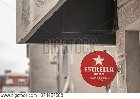 Belgrade, Serbia - May 3, 2020: Estrella Damm Logo In Front Of A Local Retailer Bar In Belgrade. Cer
