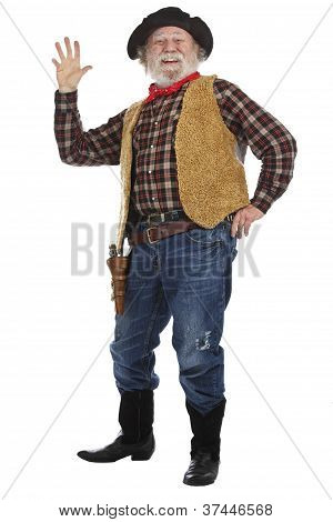 Cheerful Old Cowboy Stands And Waves