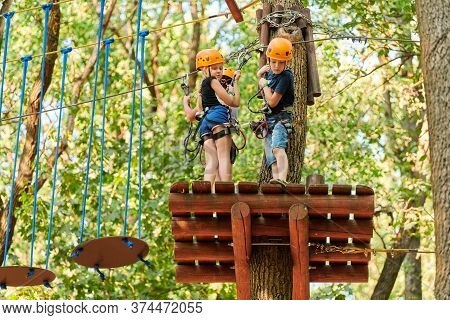 Voronezh, Russia, 23.08.2019 - Kids In High Ropes Experience Adventure Tree Park. Children On Rope R