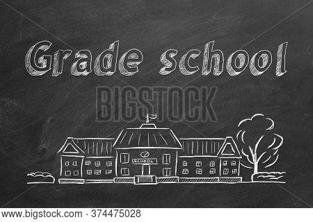 School Building  And Lettering Grade School On Blackboard. Hand Drawn Sketch.