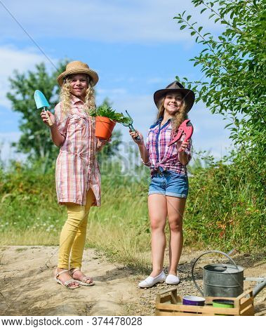 On Way To Family Farm. Taking Care Of Plants. Girls With Gardening Tools. Sisters Helping At Farm. E