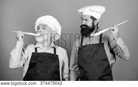 Culinary Dynasty. Mature Bearded Men Professional Restaurant Cooks. Chef Men Cooking. Teaching Culin