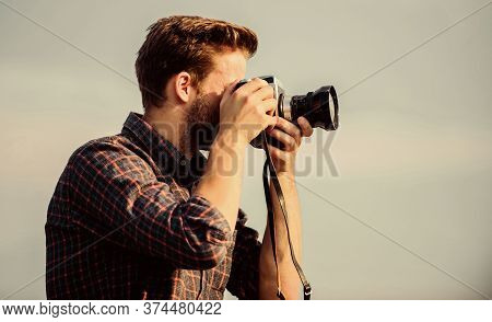 Vintage Equipment. Hipster Photographer. Blogger Shooting Vlog. Guy Outdoors Blue Sky Background. Ha