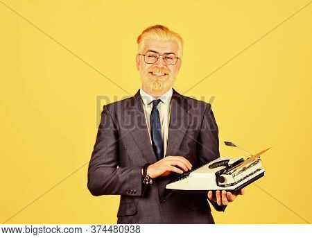Mature Man Dyed Beard Hair. Professional Typist Make Notes. Modern And Old Technology. Digital Busin