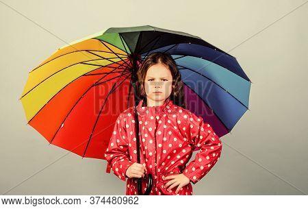 Rainy Weather With Proper Garments. Rainy Day Fun. Happy Walk Under Umbrella. There Is Rainbow Alway