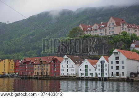 Old Vintage Houses And Classic Architecture Of Bryggen In Town Of Bergen In Norway