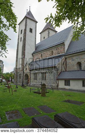 Bergen, Norway - May 31, 2017: Mariakirken, St. Mary's Church With Its Graveyard In Sandviken, Berge