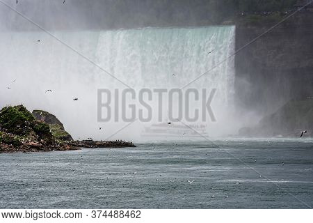 Tourist Boat In The Mist Under Horseshoe Falls On The Niagara River