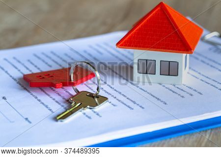 The Orange House Is Placed Near The Red House Key Ring. On Sales Contract Real Estate Ideas, Mortgag