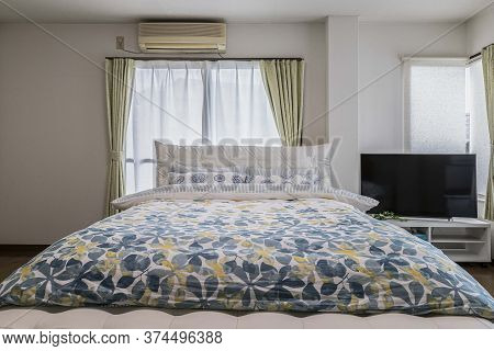 Single Bed And Blanket In A Small Bedroom For Single People