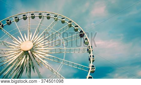 Ferris Wheel Over Cloudy Sky During Sunset