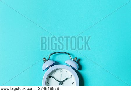 Simply Minimal Design Ringing Twin Bell Vintage Classic Alarm Clock Isolated On Blue Pastel Backgrou