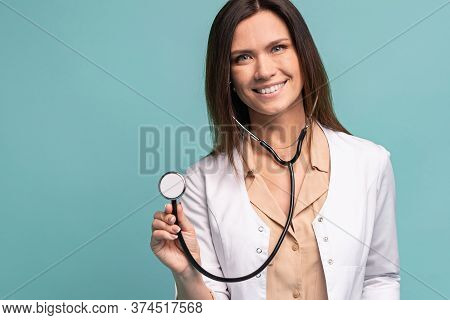 Young, Smart And Professional Doctor Isolated On Light Blue.