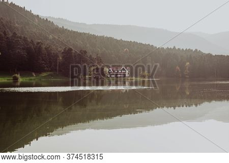 Beautiful Landscape In Autumn With Mountains And Trees Reflecting On A Calm Lake Like A Mirror, Refl