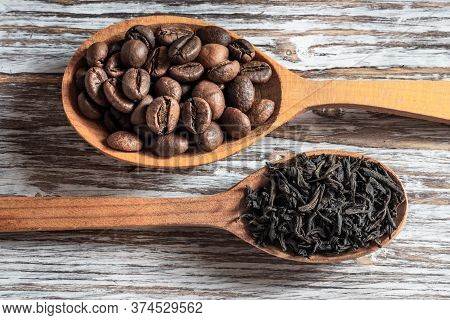 Coffee Beans And Tea In A Tablespoon. What To Drink - Coffee Or Tea