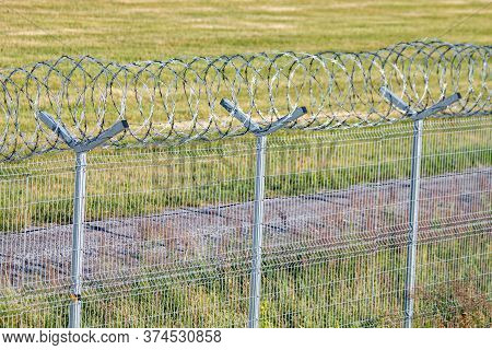 Fence Fenced With Barbed Wire. Symbol Of Freedom. Fenced Area. Place Of Imprisonment Or Border.  Res