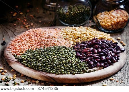 Set Of Dried Leguminous Vegetables, Red And Green Lentils, Purple Beans, Yellow Peas, Vintage Wooden