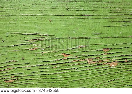 Old Green Board With Cracks.background Texture Made Of Old Boards Of Dark Green Or Sea-green Color,