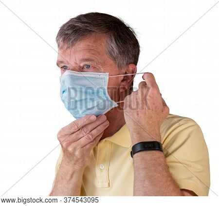 Senior Caucasian Man Adjusting His Face Mask And Looking Very Tense And Concerned About Coronavirus