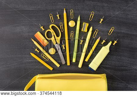 Back To School Autumn Concept. Top Above Overhead View Photo Of Set Falling Yellow Stationery And Pe
