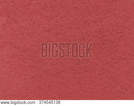 Red Old Concrete Texture. Simple Background. Stock Photo.