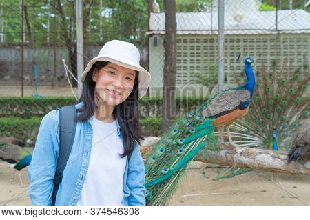 Happy Asian Woman, A Tourist, Traveling And Taking A Photo Or Selfie By Mobile Smart Phone To Post O